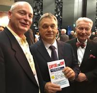 Prime Minister Orbán Viktor, Tony Kez and Szilveszter E. Vizi, promoting CAPITALlessISM by Dr. Anthony Horvath